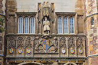 UK, England, Cambridge.  Statue of Henry VIII, founder of Trinity College, 1546.  Beneath the statue are the coats of arms of King Edward III and his six sons.  The blank one is that of William Hatfield, who died in infancy.