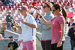 Los Angeles, CA 04/22/16 - USC coaches (l to r) Devon Wills, Alyssa Leonard and Lindsey Munday observe the team line up announcement. in action during the NCAA Stanford-USC Division 1 women lacrosse game at the Los Angeles Memorial Coliseum.  USC defeated Stanford 10-9/