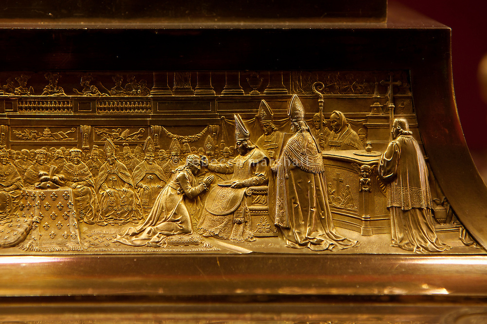"""Detail showing Clovis being baptised by Saint Remi in 496 in gold-plated silver on the base of the Sainte-Ampoule, or """"holy flask"""", which was made in 1822 to contain the holy oil with which new kings were anointed during coronation ceremonies, Musée de l'Œuvre, Palais du Tau, Reims, France, 10 November 2015. The Palais du Tao, which adjoins the cathedral of Notre-Dame de Reims, was the former residence of the archbishops and served as the royal palace during coronations."""