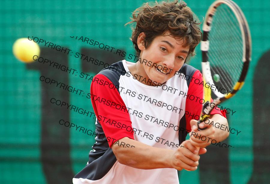 Tenis, World Championship U-14.Australia Vs. Chile, boys.Blake Mott Vs. Christian Garin.Christian Garin, returnes.Prostejov, 04.08.2010..foto: Srdjan Stevanovic/Starsportphoto ©