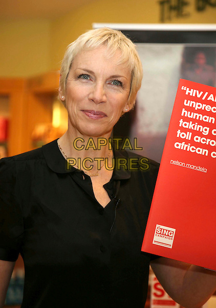 "ANNIE LENNOX.Launched her new charity CD ""Sing"" at The Body Shop, Oxford Street, London, England, 10th March 2008..half length black shirt holding sign about HIV and AIDS.CAP/DS.?Dudley Smith/Capital Pictures"