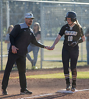 NWA Democrat-Gazette/BEN GOFF @NWABENGOFF<br /> Kent Early, Bentonville head coach, congratulates Katelyn Harris after she reached third Tuesday, April 10, 2018, during the game against Bentonville West at Bentonville West's Wolverine Athletic Complex in Centerton.