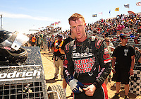 Apr 17, 2011; Surprise, AZ USA; LOORRS driver John Fitzgerald after winning round 4 at Speedworld Off Road Park. Mandatory Credit: Mark J. Rebilas-