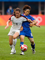 USWNT midfielder (9) Heather O'Reilly is grabbed by Japanese midfielder (8) Aya Miyama while playing at Qinhuangdao Stadium. The US defeated Japan, 1-0, during first round play at the 2008 Beijing Olympics in Qinhuangdao, China.
