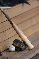 A ball, glove, and bat rest on the bench during a game between the Salem-Keizer Volcanoes and the Hillsboro Hops at Ron Tonkin Field on July 26, 2015 in Hillsboro, Oregon. Hillsboro defeated Salem-Keizer, 4-3. (Larry Goren/Four Seam Images)