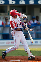 27 September 2009: Yulieski Gourriel of Cuba makes contact during the 2009 Baseball World Cup gold medal game won 10-5 by Team USA over Cuba, in Nettuno, Italy.