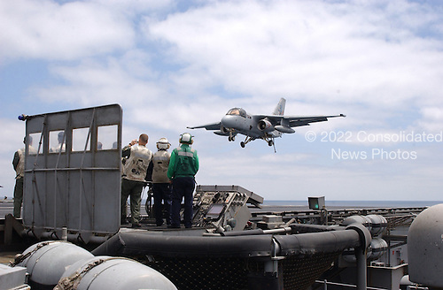 """United States President George W. Bush successfully traps aboard the USS Abraham Lincoln (CVN 72) in a S-3B Viking assigned to the Blue Wolves of Sea Control Squadron Three Five (VS-35) designated """"NAVY 1"""" on May 1, 2003.   President Bush is the first sitting President to trap aboard an aircraft carrier at sea. The President is conducting a visit aboard ship to meet with the Sailors and will address the Nation as Lincoln prepares to return from a 10-month deployment to the Arabian Gulf in support of Operation Iraqi Freedom. <br /> Credit: United States Navy via CNP"""
