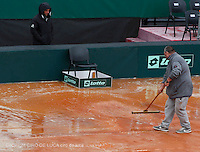 the rain stops the beginning of the quarter-finals of the Davis Cup  tennis match between Italy and Great Britain in Naples April 4, 2014.