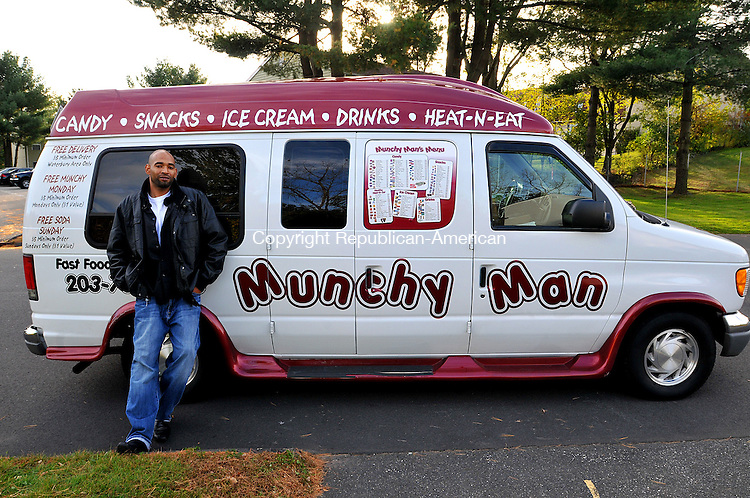 WATERBURY, CT, 28 OCTOBER 2011-102811JS23--Corey Wade of Waterbury, known as the Munchy Man, with his van at the Mayberry Circle apartment complex in Waterbury recently while promoting his new business. <br /> Jim Shannon Republican-American