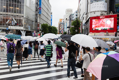 Pedestrians hold umbrellas in the rain at Shibuya scramble crossing on July 9, 2016, Tokyo, Japan. The annual rainy season or Tsuyu in Japan runs from June until mid-July. (Photo by Rodrigo Reyes Marin/AFLO)