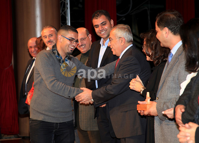 Palestinian Prime Minister Salam Fayyad, attends the national festival for honoring the Palestinian volunteers ?Ounah?, in the West Bank city of Ramallah, on 05 December 2012. Photo by Mustafa Abu Dayeh