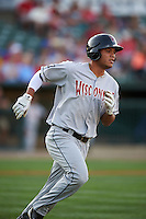 Wisconsin Timber Rattlers outfielder Elvis Rubio (17) runs to first during a game against the Peoria Chiefs on August 21, 2015 at Dozer Park in Peoria, Illinois.  Wisconsin defeated Peoria 2-1.  (Mike Janes/Four Seam Images)