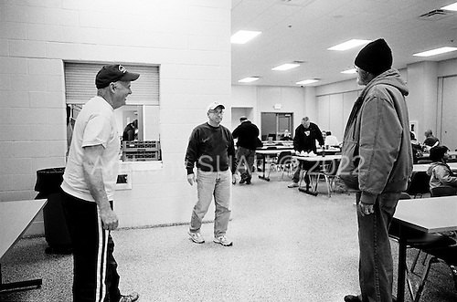 Elkhart, Indiana<br /> USA<br /> March 27, 2009<br /> <br /> Ed Newfeldt, 62, (black hat) and friend Pete Swathwood, 58, eat lunch at the Faith Mission soup kitchen after being laid off from Monaco Coach, one of the nation's leading recreational vehicle manufacturers, after more then 30 years. Both are on unemployment and are volunteers for the mission.<br /> <br /> Monaco Coach is one of 10 factories to shut its doors in the area currently with an unemployment rate of more then 20%.