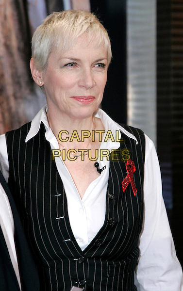 ANNIE LENNOX.RTL donations Marathon 2008, Cologne, Germany..November 20th, 2008.half length white shirt black pinstripe waistcoat red ribbon.CAP/PPG/PF.©Patric Fouad/People Picture/Capital Pictures