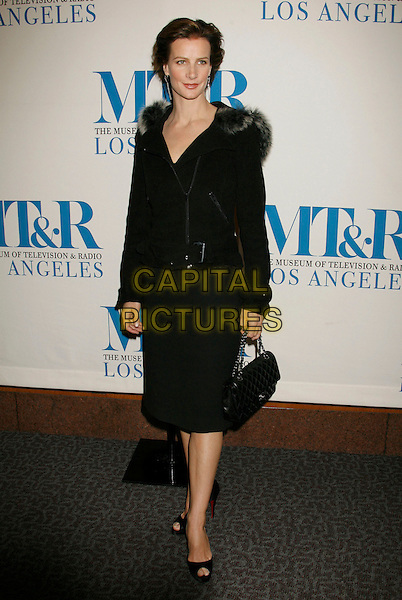 "RACHEL GRIFFITHS.The Museum Of Television and Radio presents The Twenty-Fourth Annual William S. Paley Television Festival, ""Brothers and Sisters"" held at the Directors Guild Of America, West Hollywood, California, USA..March 5th, 2007.full length black dress skirt jacket fur trim bag purse .CAP/ADM/RE.©Russ Elliot/AdMedia/Capital Pictures"