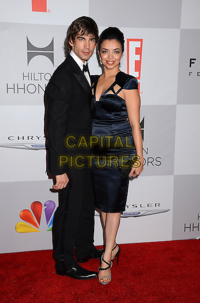 Christopher Gorham and Anel Lopez Gorham.NBC Universal Golden Globes After Party held at the Beverly Hilton Hotel, Hollywood, California, USA..January 15th, 2012.full length black dress suit tuxedo married husband wife.CAP/ADM/BT.©Birdie Thompson/AdMedia/Capital Pictures.