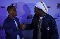 "Snoop Dogg now known as Snoop Lion poses with NY Giants Victor Cruz while they attend an event organized by MLB and EA Sports for launching the last soccer game named ""FIFA Soccer 13"" in New York . Photo by Eduardo Munoz Alvarez / VIEW."