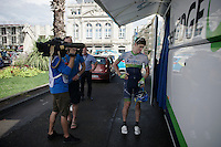 Luke Durbridge (AUS/Orica-GreenEDGE) about to be interviewed straight after arriving at the teambus<br /> <br /> 2014 Tour de France<br /> stage 15: Tallard - Nîmes (222km)