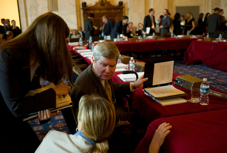 WASHINGTON, DC - July 17: Sen. Tim Johnson, D-S.D., talks with aides before the markup of fiscal 2009 military construction, agriculture and state-foreign operations  bills. (Photo by Scott J. Ferrell/Congressional Quarterly)