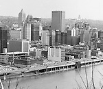 Pittsburgh PA:  View of the city's skyline - 1962.  View includes construction of the Pittsburgh Press Building and downtown Pittsburgh.  View also includes the many businesses along Fort Pitt Boulevard.