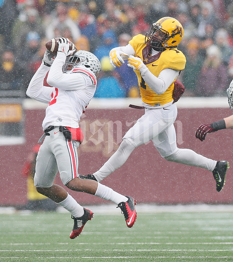 Ohio State Buckeyes defensive back Vonn Bell (11) intercepts the ball in front of Minnesota Golden Gophers wide receiver KJ Maye (1) in the second half at TCF Bank Stadium on November 15, 2014. (Chris Russell/Dispatch Photo)