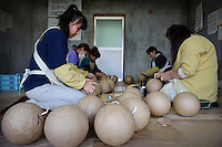 "Making fireworks at Katakai Fireworks Co., Ltd, Katakai, Japan, April 6, 2009. The company makes the world's largest firework, a 120cm round shell called a ""yonshakudama""."