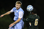 21 November 2013: USF's Duane Muckette (TRI) (6) heads the ball past North Carolina's Cooper Vandermaas-Peeler (left). The University of North Carolina Tar Heels hosted the University of South Florida Bulls at Fetzer Field in Chapel Hill, NC in a 2013 NCAA Division I Men's Soccer Tournament First Round match. North Carolina won the game 1-0.