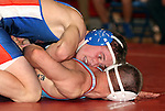 SIOUX FALLS, SD - DECEMBER 28:  Blake Bietz from Parkston has control of Skyler Castilleja from Lincoln in their 132 pound championship match Saturday afternoon December 28, 2013 at Lincoln High School in Sioux Falls, South Dakota. (Photo by  Dave Eggen/Inertia)