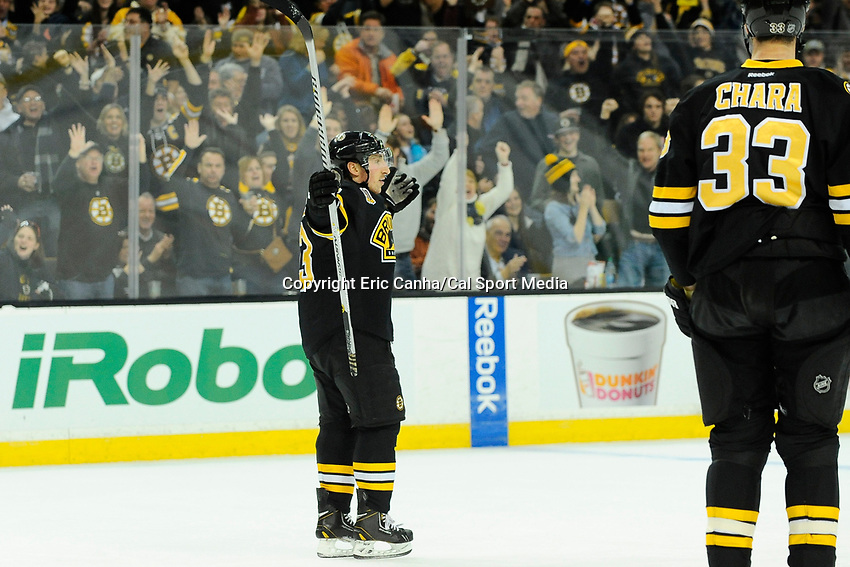 January 20, 2014 - Boston, Massachusetts, U.S. - Boston Bruins left wing Brad Marchand (63) celebrates a goal during the NHL game between Los Angeles Kings and the Boston Bruins held at TD Garden in Boston Massachusetts.  Eric Canha/CSM