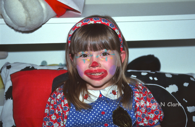 Girl with painted clown face