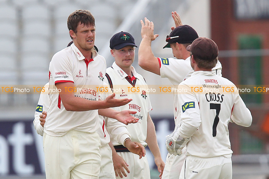Wayne White of Lancashire (L) celebrates the wicket of James Foster - Lancashire CCC vs Essex CCC - LV County Championship Division Two Cricket at Emirates Old Trafford, Manchester - 07/05/13 - MANDATORY CREDIT: Gavin Ellis/TGSPHOTO - Self billing applies where appropriate - 0845 094 6026 - contact@tgsphoto.co.uk - NO UNPAID USE.
