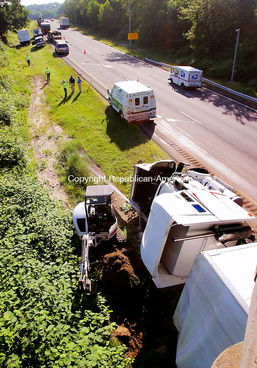 MIDDLEBURY CT. 30  June 2008-063008SV01--A tractor trailer driver fell asleep and rolled his truck over under a bridge on I84 east at exit 17 in Middlebury early Monday morning.<br /> Steven Valenti Republican-American