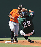 Ronald Bermudez (22) of the Greenville Drive slides with his hands high attempting a steal, but second baseman Juan Martinez (14) of the Augusta GreenJackets already has the ball and makes the tag in a game on May 23, 2010, at Fluor Field at the West End in Greenville, S.C.