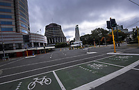 The Beehive and empty streets at the corner of Lambton Quay and Whitmore Street at lunchtime on Thursday. Wellington CBD during quarantine lockdown for COVID19 pandemic in Wellington, New Zealand on Thursday, 2 April 2020. Photo: Dave Lintott / lintottphoto.co.nz