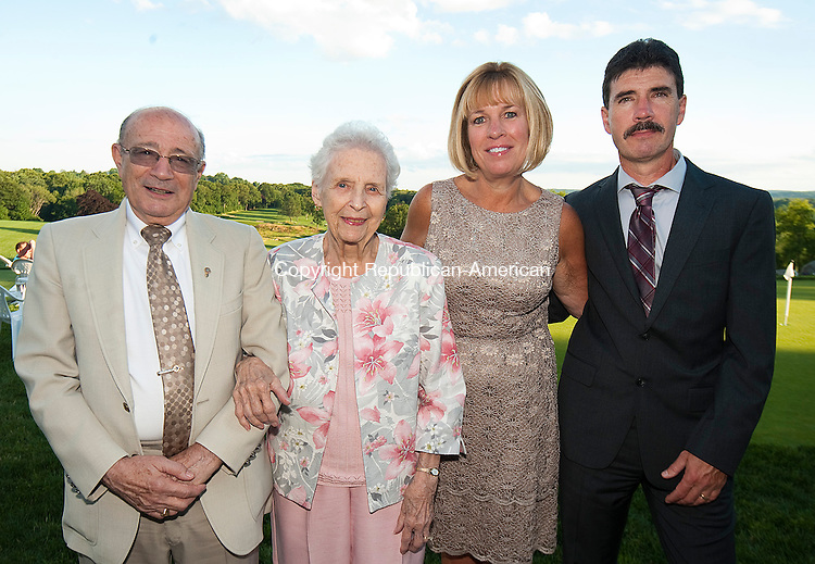 WATERBURY, CT--- -062615JS06-- Bill and Ruth-Ellen Summa of Waterbury with Randi and Davie Bellemare of Beacon Falls at the 85th anniversary dinner for the Greater Waterbury Lion's Club held at the Country Club of Waterbury. <br /> Jim Shannon Republican-American