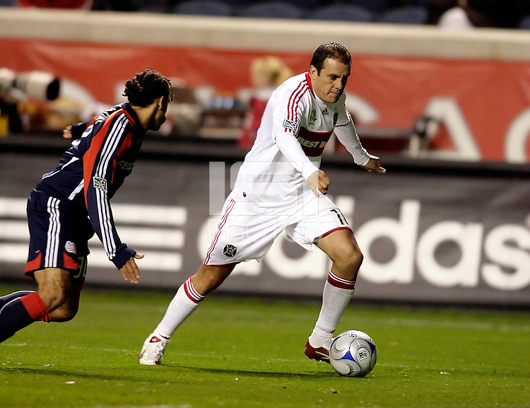 Chicago Fire midfielder Cuauhtemoc Blanco (10) dribbles away from New England midfielder Kevin Alston (30).  The Chicago Fire tied the New England Revolution 1-1 at Toyota Park in Bridgeview, IL on May 9, 2009.
