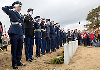 NWA Media/JASON IVESTER --12/13/2014--<br /> Military personnel salute after placing wreaths on headstones on Saturday, Dec. 13, 2014, during the Wreaths Across America ceremony at the Fayetteville National Cemetery. Wreaths were placed at each of the 7100 veteran graves in the cemetery.