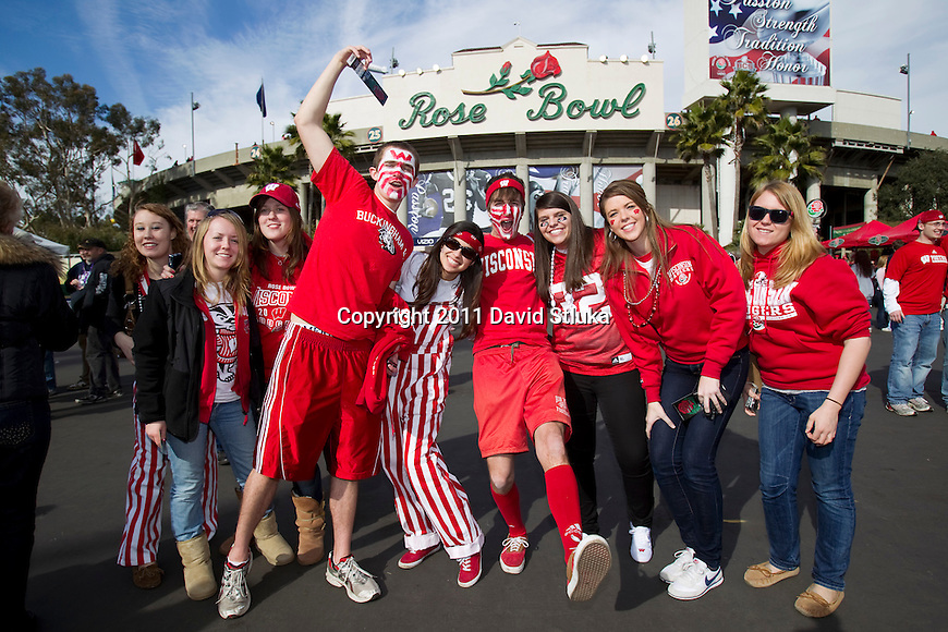 Wisconsin Badgers fans pose for a photo outside the Rose Bowl prior to the 2011 Rose Bowl NCAA Football game against the TCU Horned Frogs in Pasadena, California on January 1, 2011. TCU won 21-19. (Photo by David Stluka)