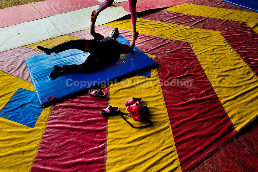 """Students perform in pair an acrobatics act during the lessons in the circus school Circo para Todos in Cali, Colombia, 28 June 2014. Circo Para Todos (""""Circus for All""""), founded by Felicity Simpson, a former British circus performer, is the first professional circus school in the world specifically dedicated to disfavoured kids and talented street children. Students are trained in a range of circus art skills including acrobatics, balancing, juggling, stilt walking or unicyling. After finishing the four-year course, graduates may find jobs in circuses in the world or in the cruise ships."""