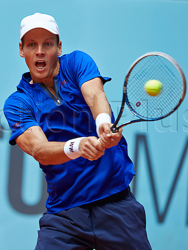 07.05.2014 Madrid, Spain. Tomas Berdych of Czech Republic plays a backhand during the game with Kevin Anderson of RSA on day 4 of the Madrid Open from La Caja Magica.