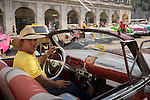 Havana, Cuba:<br /> Classic convertable triver on Centro Habana street