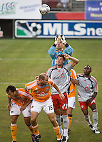 Houston Dynamo goalkeeper Pat Onstad (18) punches the ball away on a Toronto FC corner kick as Toronto FC forward Jarrod Smith (23) attempts to get a head on the ball.   Houston Dynamo defeated Toronto FC 3-1 at Robertson Stadium in Houston, TX on June 8, 2008.