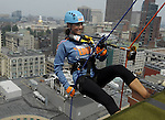 (Boston Ma, 072013) A smiling Jenny Dell of NESN  goes over the edge as she rappels down the Hyatt Regency to raise money for Special Olympics, Saturday in downtown Boston. (Jim Michaud Photo) Track