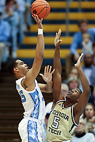 CHAPEL HILL, NC - JANUARY 4: Garrison Brooks #15 of the University of North Carolina shoots over Moses Wright #5 of Georgia Tech during a game between Georgia Tech and North Carolina at Dean E. Smith Center on January 4, 2020 in Chapel Hill, North Carolina.