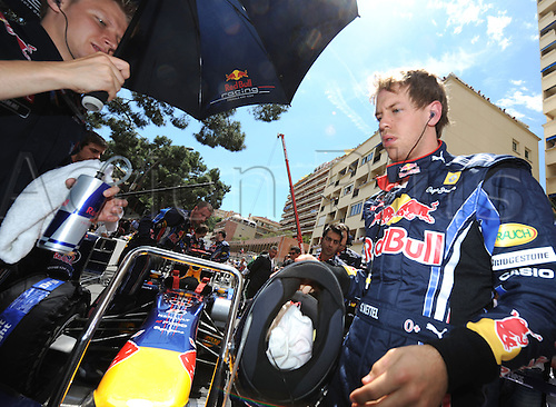 German driver Sebastian Vettel of Red Bull Racing prepares in the grid for the 2010 Formula 1 Grand Prix of Monaco held in the street circuit of Monte Carlo, Monaco, 16 May 2010. Australia's Webber of Red Bull Racing won the prestigious Grand Prix ahead of German team-mate Vettel and Poland's Kubica of Renault F1.