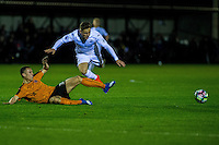 Friday  16 December 2014<br /> Pictured:  Joel Whittingham Wolverhampton Wonderers sends Keiran Evans  of Swansea City flying<br /> Re: Swansea City U18s v Wolverhampton Wonderers U18s, 3rd Round FA youth Cup Match at the Landore Training Facility, Swansea, Wales, UK