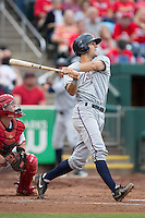 Mitch Canham (6) of the Northwest Arkansas Naturals follows through his swing after making contact on a pitch during a game against the Springfield Cardinals at Hammons Field on July 28, 2013 in Springfield, Missouri. (David Welker/Four Seam Images)