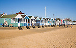 Colourful beach huts and sand, Southwold, Suffolk, England