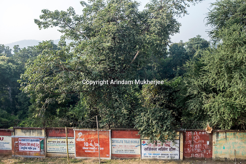 The compound wall of the Uranium Corporation of India Ltd (UCIL) in Jaduguda. This public sector company under the Department of Atomic Energy of the Indian government operates the seven mines and mills in and around Jaduguda. Production started in the Jaduguda mines in 1967.