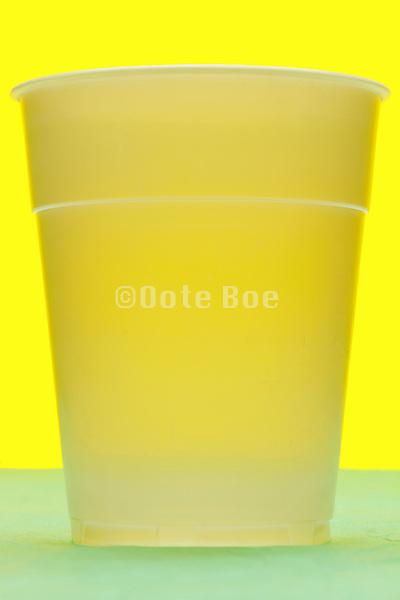 white semi transparent plastic cup still life
